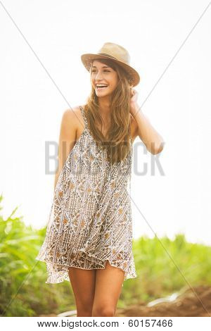 Beautiful woman smiling, Happy girl on sunny summer day outside. Laughing and smiling. Carefree healthy lifestyle