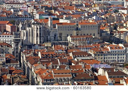 Carmo Convent, Santa Justa Elevator and rooftops of the historical Baixa District (downtown) of Lisbon, Portugal.