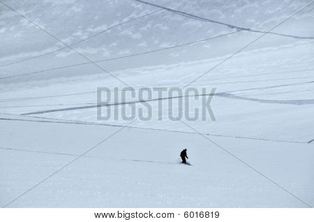 Silhouette Of Skier On Glacier
