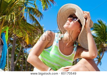 Woman Under Palm Tree At Beach