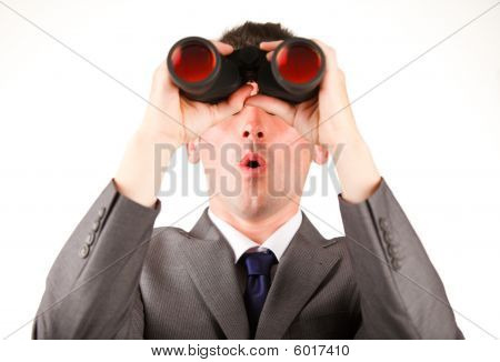 Young Businessman Looking Through Binoculars