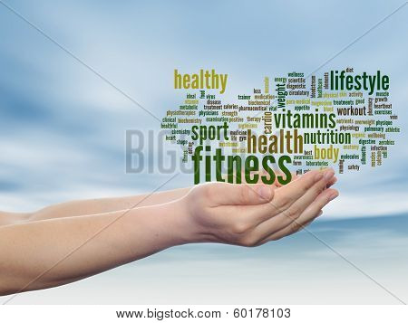 Concept or conceptual abstract fitness and health word cloud man hand, blue sky background