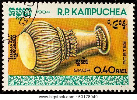 KAMPUCHEA-CIRCA 1984: A stamp printed in the Cambodia, shows a traditional musical instrument Skor, circa 1984