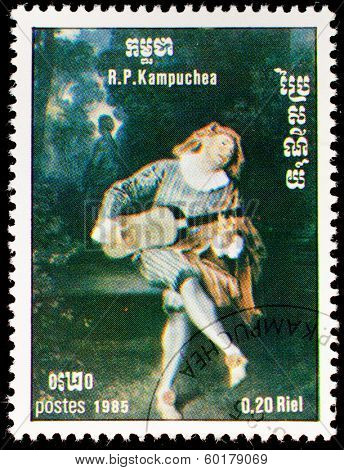 Kampuchea-CIRCA 1985: A stamp printed in the Kampuchea, depicts a harlequin playing guitar, circa 1985
