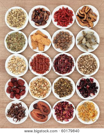 Chinese herbal medicine selection in white china bowls.