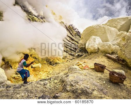 Sulfur Miner Extracting Sulfur from Inside the Crater of Kawah Ijen Volcano