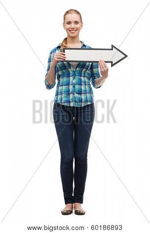 happiness, direction and people concept - smiling young woman arrow poiting