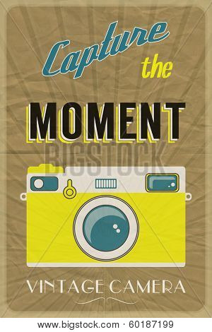 Retro photographic poster with the slogan Capture the Moment, on crumpled brown paper background. EPS10 vector format