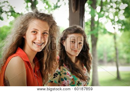 Portrait of two nice and smiling teenager girl