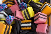 image of licorice  - Closeup of Licorice Allsorts on a plate - JPG