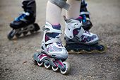 image of roller-skating  - two pairs of roller skates - JPG