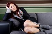 pic of boring  - Pretty young woman bored on sofa - JPG