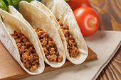 stock photo of tacos  - tacos with beef and chilli on old wooden table rustic style - JPG
