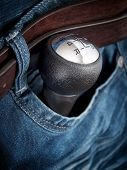 stock photo of gear-shifter  - Gear shift knob in the pocket as a symbol of car enthusiasts.