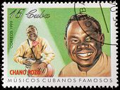 CUBA - CIRCA 1999: A stamp printed in cuba dedicated to famous Cuban musicians, shows Chano Pozo, ci
