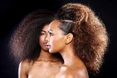 stock photo of daydreaming  - Beautiful Stunning Portrait of Two African American Black Women With Big Hair - JPG