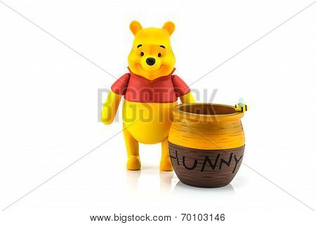 Figure of Winnie the Pooh and hunny pot