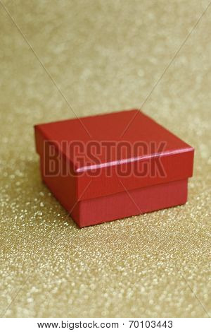 Red Box And Background In Gold With Stars