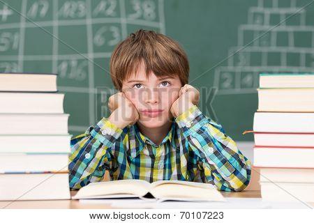 Grumpy Little Boy In Class