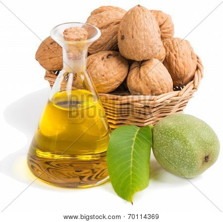 Walnut Oil In A Glass Bottle With Nuts