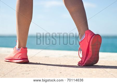 Close-up Of A Woman's Running Shoes