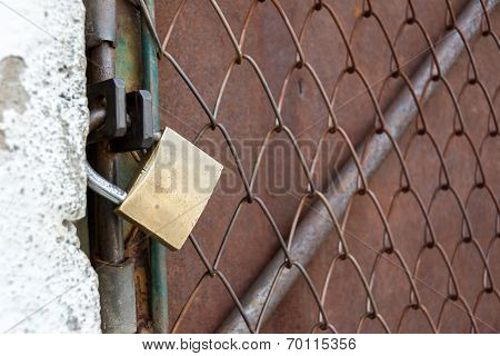 Metallic Door Closed And Locked With A Padlock