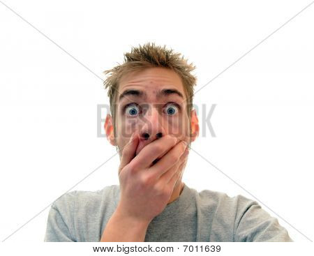Man Holding Hand Up To Mouth