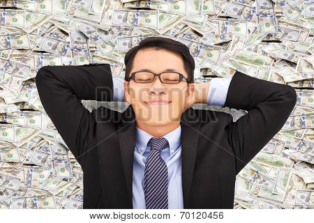 Business Man Enjoying And Lying On The Money