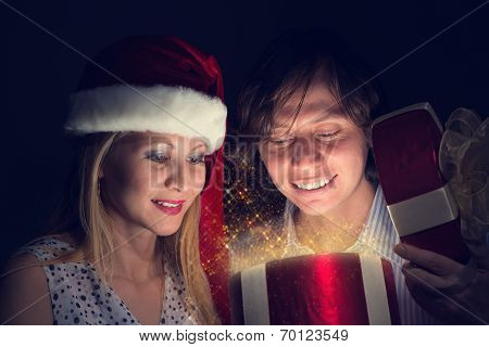 couple opens a box of magic