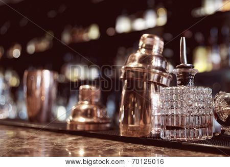 Bartender tools on old style bar counter, toned image