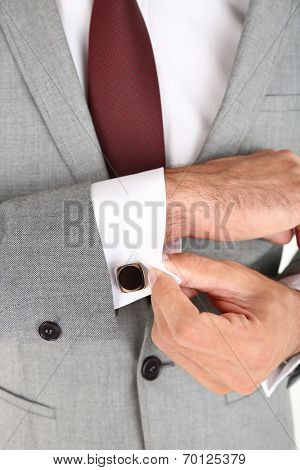 Man doing collar button up isolated on white  closeup