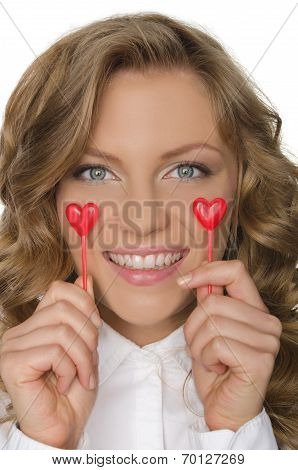 Young Woman Keeps Hearts Under The Eyes