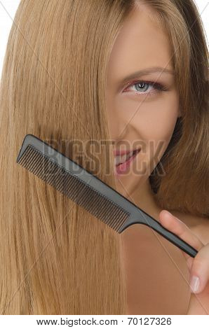Beautiful Woman Holding Comb Straightened Hair