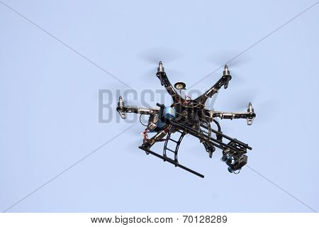 drone with digital camera flying in the sky