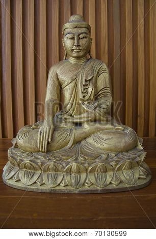 Wooden Budha On Table