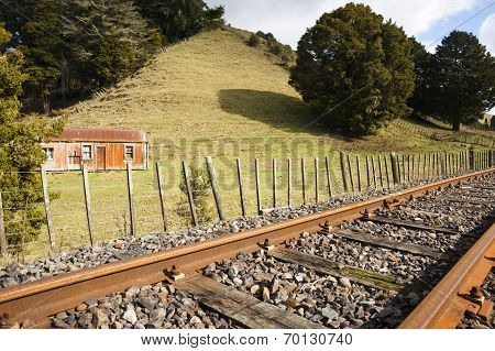 Railway And Old Cottage.