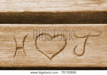 Initials Of A Love Couple, Carved In A Bench Plank