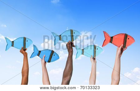 People Holding Fish Symbols and Leadership Concept