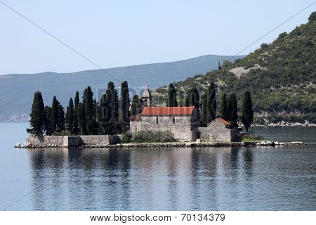 PERAST, MONTENEGRO - JUNE 08: Church of St George. Island of Saint George is one of the two islets off the coast of Perast in Bay of Kotor, Montenegro, on Jun 08, 2012