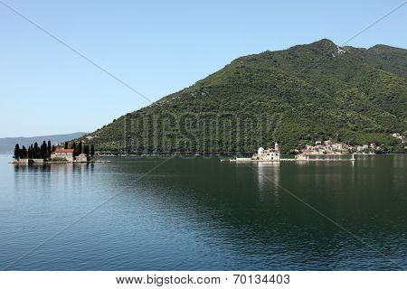 PERAST, MONTENEGRO - JUNE 08: The Church of St. George (left) and Dome of the Rock (right). Perast in Bay of Kotor, Montenegro, on June 08, 2012