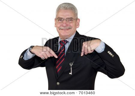 smiling senior manager pointing at key