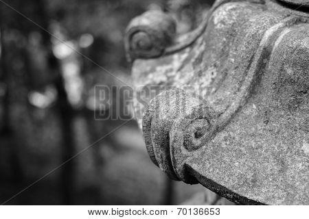 Traditional asian stone lantern in garden.