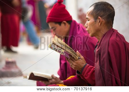 KATHMANDU, NEPAL - DEC 2, 2013: Unidentified pilgrims circle stupa Boudhanath. Ancient Stupa is one of the largest in the world, of 1979 is a UNESCO World Heritage Site.