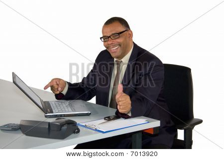 sucessful businessman with laptop posing thumbs up