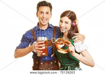 Smiling man and happy woman at Oktoberfest with beer and pretzel in their hands
