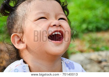 The girl is laughing.