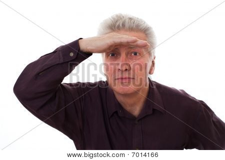 Elderly Man Holds Glasses On A White