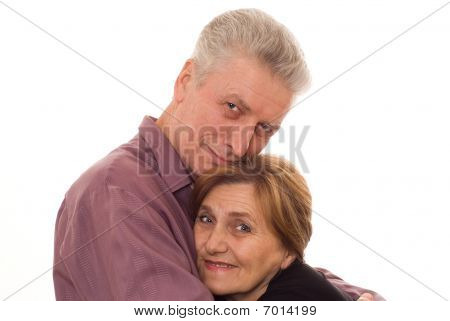Man Embraces A Woman On A White Background