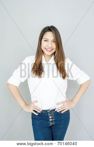 Potrait Asian Lady Mini Smile In Casual Suite White Shirt And Blue Jeans
