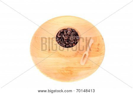 Coffe Beans In A Wooden Cup